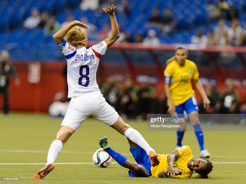 Cho Sohyun #8 of Korea Republic draws a foul by taking down Formiga #20 of Brazil in the second half during the 2015 FIFA Women's World Cup Group E match at Olympic Stadium on June 9, 2015 in Montreal, Quebec, Canada.