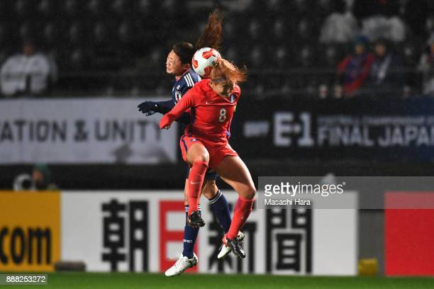 Cho Sohyun of South Korea and Rumi Utsugi of Japan compete for the ball during the EAFF E1 Women's Football Championship between Japan and South...