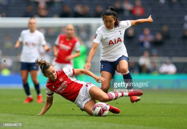 Cho So-hyun of Tottenham Hotspur is tackled by Katie McCabe of Arsenal during the Pre-season Friendly between Tottenham Hotspur Women and Arsenal...