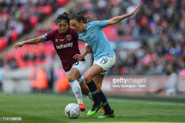 Cho Sohyun of West Ham United Ladies and Caroline Weir of Manchester City Women during the Women's FA Cup Final match between Manchester City Women...