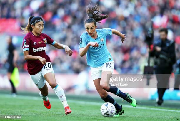 Cho SoHyun of West Ham United Ladies battles for possession with Caroline Weir of Manchester City Women during the Women's FA Cup Final match between...