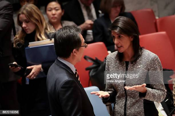 Cho Taeyul South Korean ambassador to the United Nations talks with Nikki Haley US ambassador to the United Nations during an emergency meeting of...