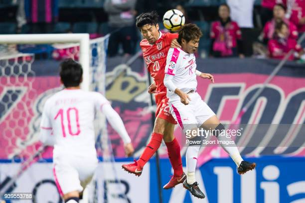 Cho YongHyung of Jeju United FC fights for the ball with Yoichiro Kakitani of Cerezo Osaka during to the AFC Champions League 2018 Group G match...