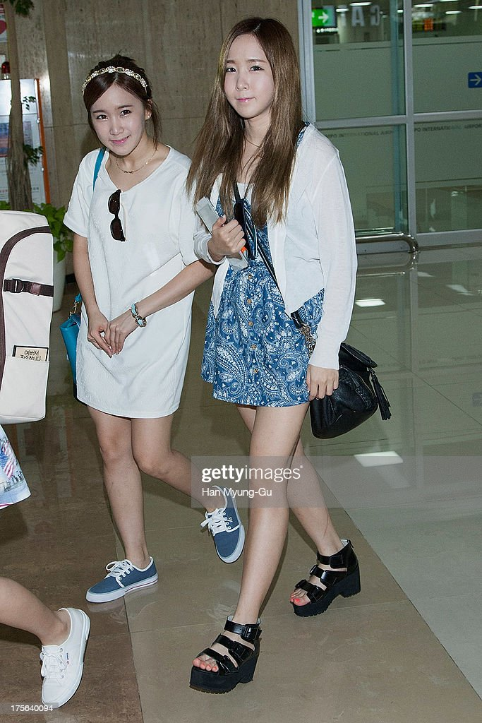Choa and Way of South Korean girl group Crayon Pop are seen upon arrival at Gimpo International Airport on August 5, 2013 in Seoul, South Korea.