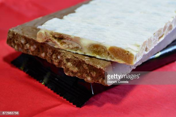 chocolate and almond nougat - marzipan stock pictures, royalty-free photos & images