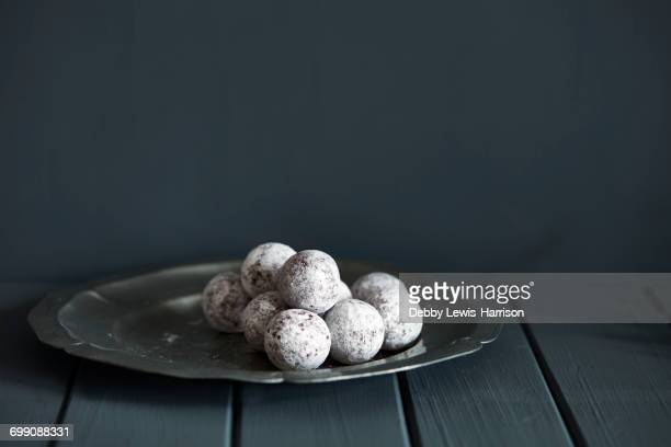 Chocolate and champagne truffles on silver plate
