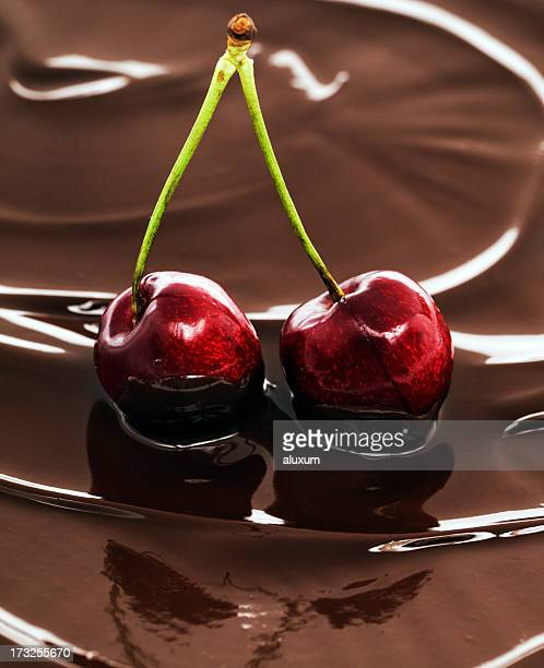 chocolate and cherries - chocolate dipped stock pictures, royalty-free photos & images
