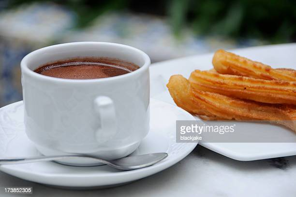 chocolate and churros - churro stock photos and pictures