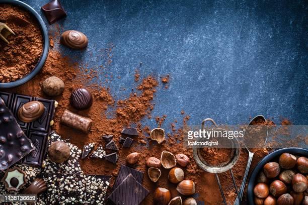 chocolate and cocoa powder frame - cioccolato foto e immagini stock