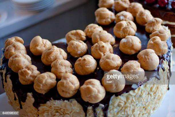 Chocolate and Cream Cake Decelerated with Flaked Almond and Puffs