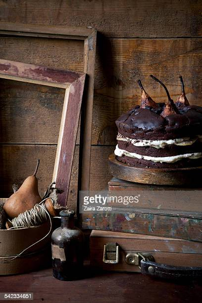 Chocolate and pears cake on rustic wooden table