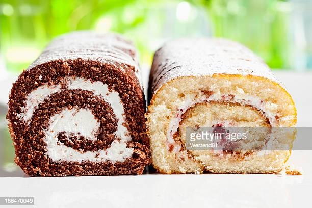 Chocolate and raspberry roll sponge cake, close up