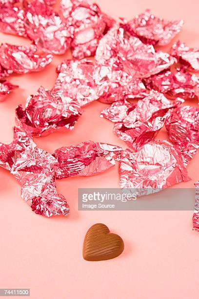 chocolate and wrappers - candy wrapper stock photos and pictures