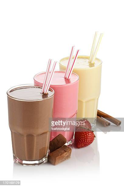 Chocolate, banana and strawberry milkshakes on white