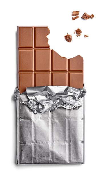 chocolate bar and crumbs on white background - chocolate bars stock pictures, royalty-free photos & images