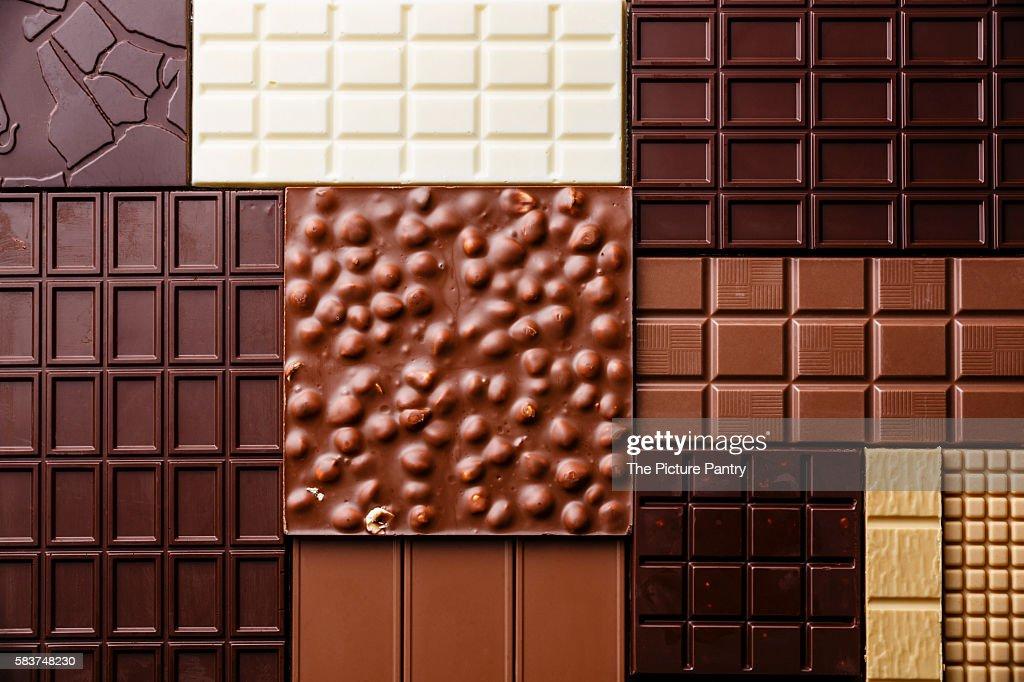 Chocolate bar assortment pattern background wallpaper : Stock Photo