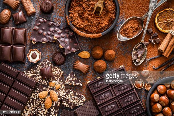 chocolate bars and cocoa powder shot from above - raw food stock pictures, royalty-free photos & images