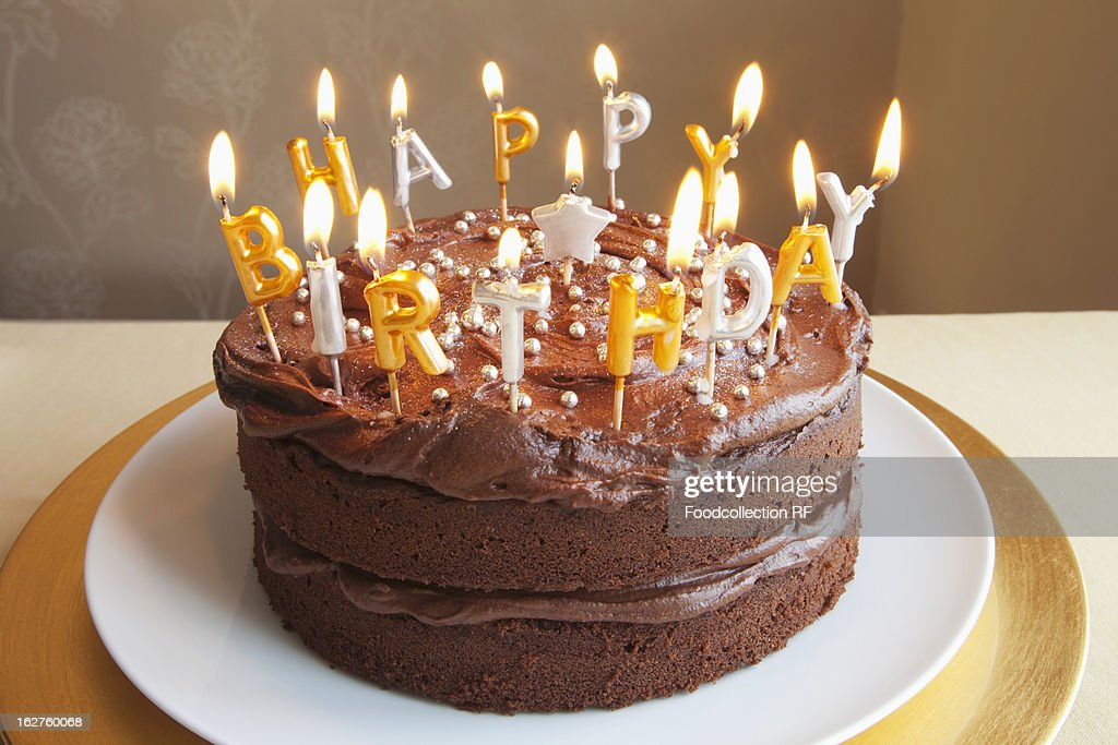 Chocolate Birthday Cake With Lots Of Candles Stock Photo Getty Images