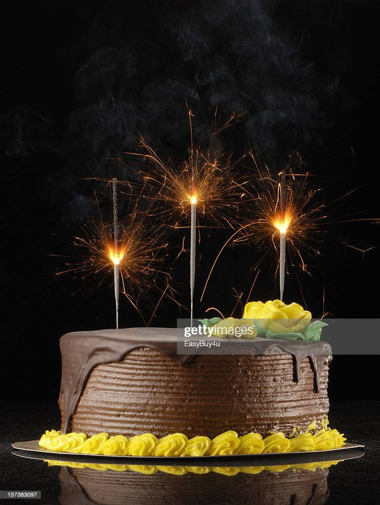 Chocolate Birthday Cake With Sparklers On A Black Background Stock Photo