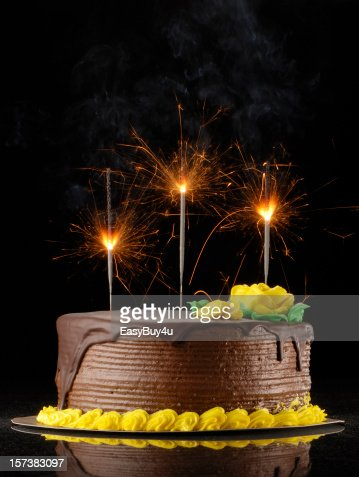 Chocolate Birthday Cake With Sparklers On A Black