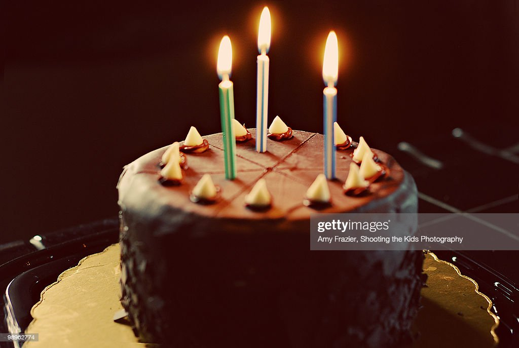 Chocolate Birthday Cake With Three Candles Stock Photo Getty Images