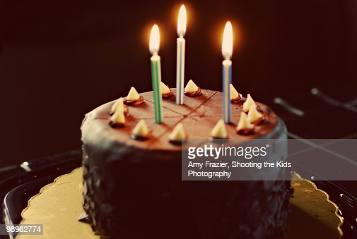 Chocolate Birthday Cake With Three Candles Stock Photo