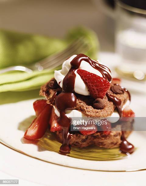 Chocolate biscuit with strawberries and whipped cream