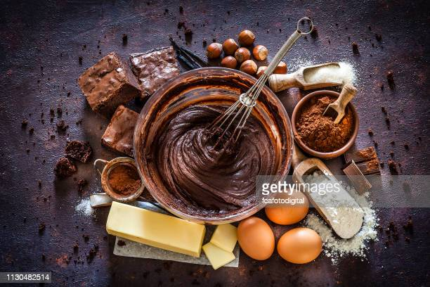 chocolate brownie ingredients on kitchen table - ingredient stock pictures, royalty-free photos & images