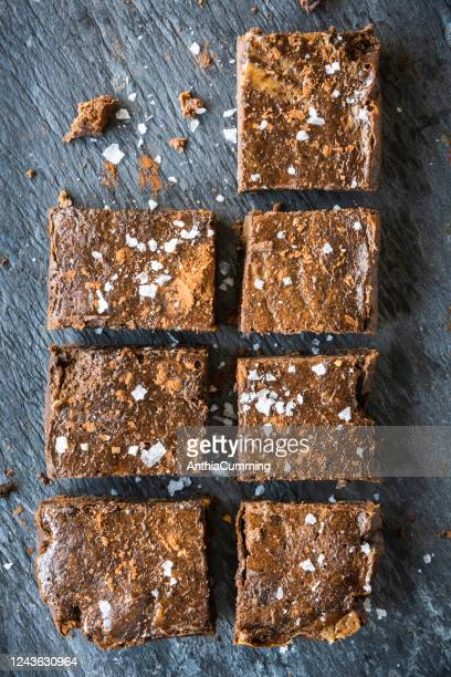 chocolate brownies on a grey slate plate - salted stock pictures, royalty-free photos & images