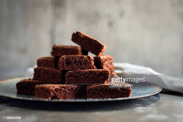 chocolate brownies on plate with napkin - brownie stock pictures, royalty-free photos & images