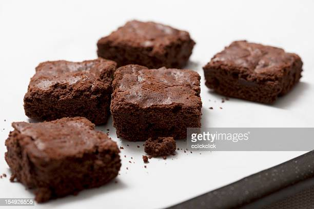 chocolate brownies on white countertop - brownie stock pictures, royalty-free photos & images