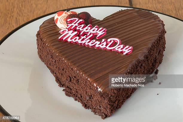 Chocolate cake for mother's day celebration of the cream on a white plate