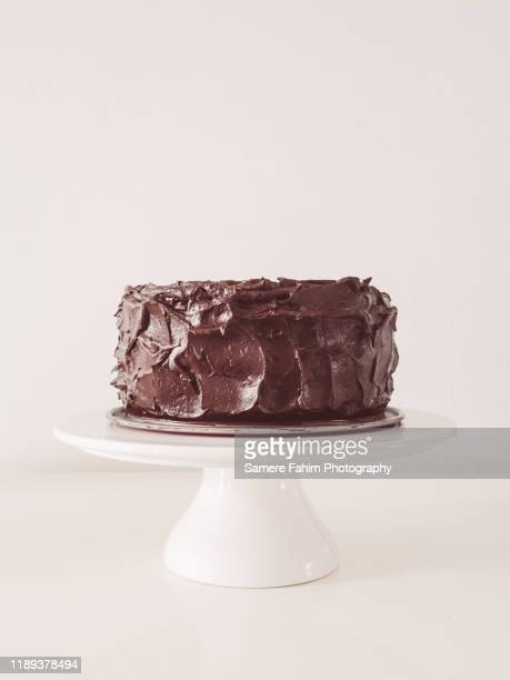 chocolate cake on display - chocolate cake stock pictures, royalty-free photos & images