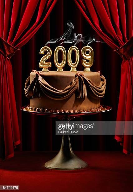 Chocolate Cake on Stage with 2009 smoking Candles