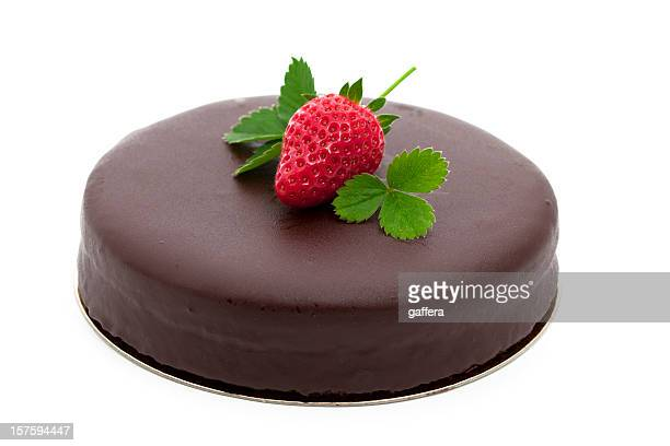 Chocolate cake topped with a strawberry