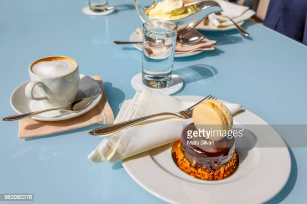 chocolate cake with a macaroon and coffee - chocolate photos stock pictures, royalty-free photos & images