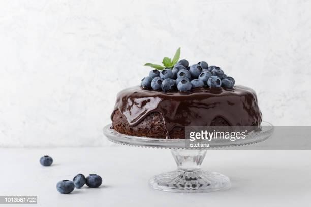 chocolate cake with chocolate glaze and blueberries - ベリー類 ストックフォトと画像