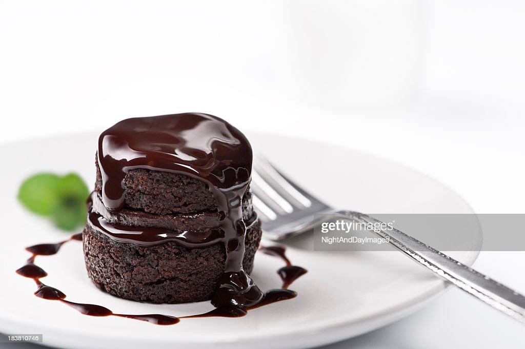 Chocolate cake with melted chocolate on top : Stock Photo