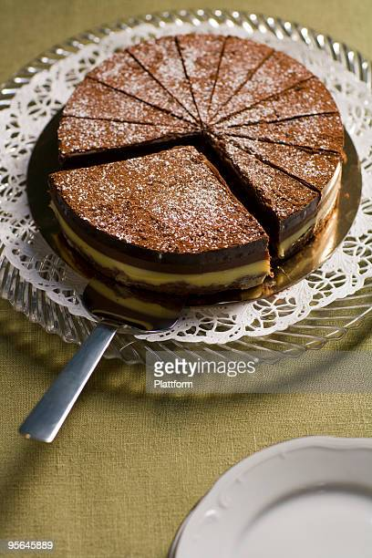 Chocolate cake with one large piece.