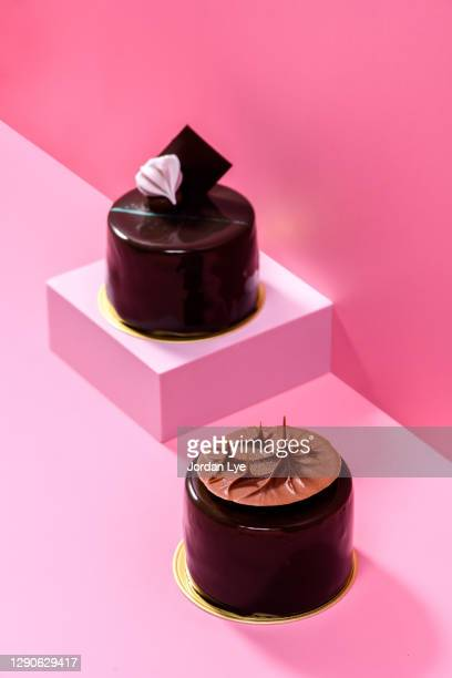 chocolate cakes display on pink background - hainaut stock pictures, royalty-free photos & images