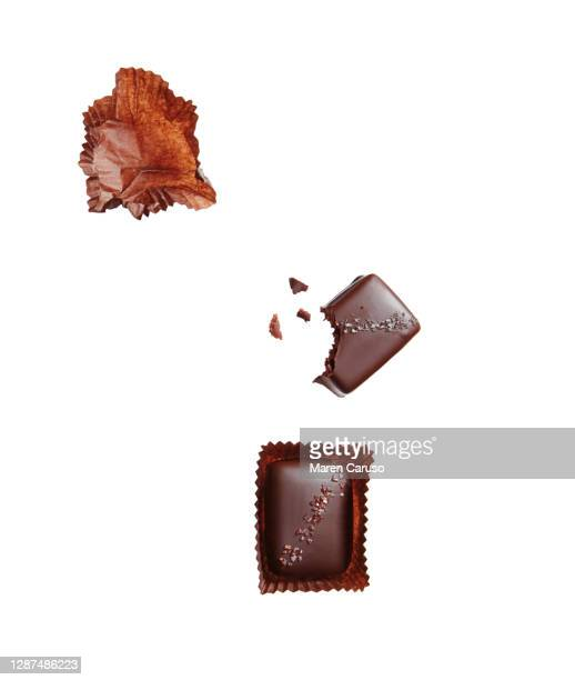 chocolate candies on white - nougat stock pictures, royalty-free photos & images