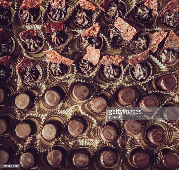 chocolate candies - chocolate pieces stock photos and pictures