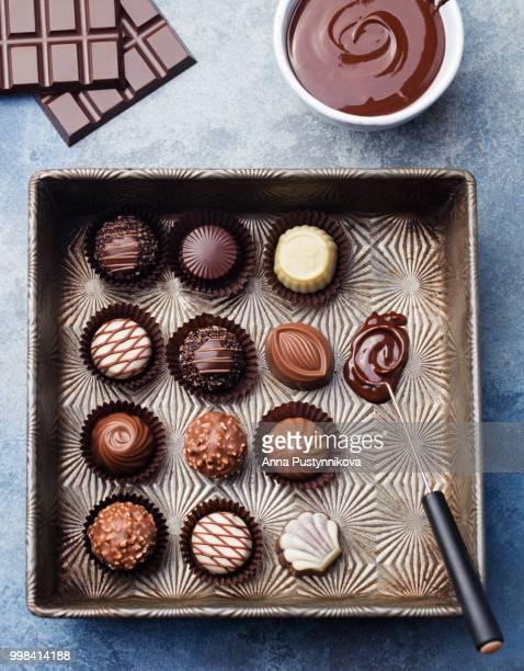 Chocolate candies, vintage dish, chocolatier tool