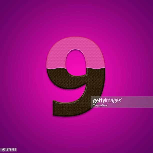 Chocolate candy number 9 nine isolated on pink background