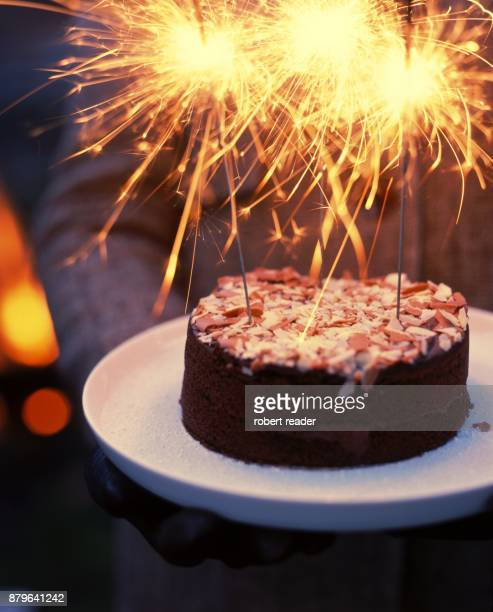 Chocolate celebration cake with flaming sparklers