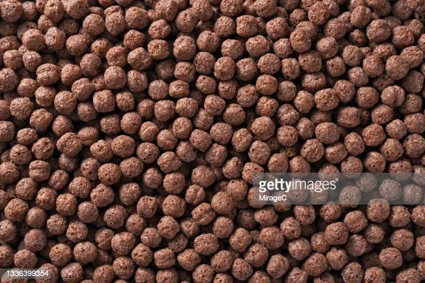 chocolate cereal balls - crunchy stock pictures, royalty-free photos & images