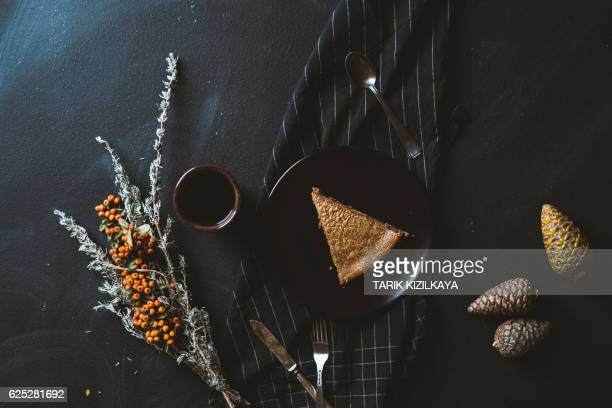 chocolate cheesecake with warm coffee on a cold winter day - chocolate cake above stock pictures, royalty-free photos & images