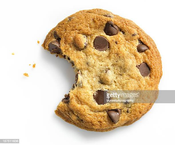 chocolate chip cookie with bite on white - snack stock pictures, royalty-free photos & images
