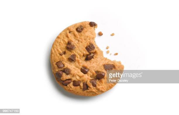 chocolate chip cookie with bite out - cookie stock pictures, royalty-free photos & images