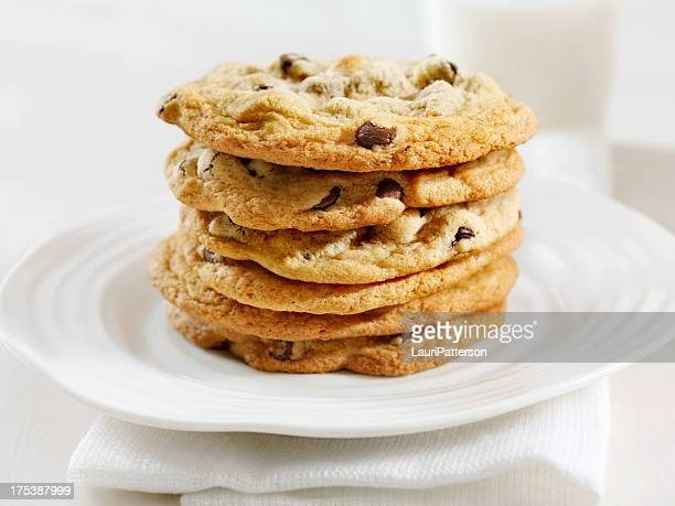 chocolate chip cookies and milk - chocolate chip cookie stock pictures, royalty-free photos & images